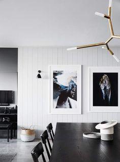 An Australian interpretation of Scandinavian Modern uses a palette of greys with metallic accen...