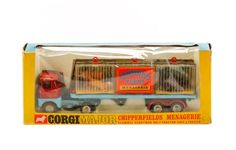 "Corgi Toys/Mettoy Company (Germany, founded 1933), circa 1968-1972. Die cast scale model with automatic trailer coupling, jeweled headlights, spring suspension, removable animal cages with sliding fronts and lifting eye; scammel handyman MK 3 tractor unit and trailer with lion, tiger and two bears. In original box approximately 4.37"" x 10.62"" x 2.37""."