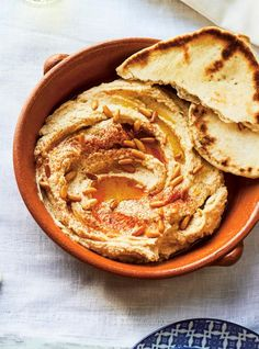 This easy recipe for creamy, addictive hummus uses ingredients you likely already have on hand. Homemade Pita Bread, Homemade Hummus, Pine Nut Hummus Recipe, Appetizer Buffet, Appetizers, Ricardo Recipe, Cozy Meals, Spicy Recipes, Easy Recipes
