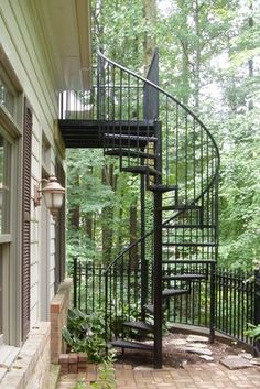 I'd LOVE to change our second story side window to a door and add a spiral staircase like this. The view would be amazing! Love the ground level patio, too.