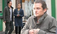 Orlando Bloom looks rather chilly on Unlocked set with Noomi Rapace