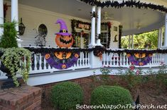 The porch on Marie's Victorian home was decorated with garland and Halloween banners.