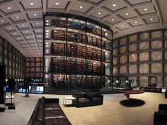 Beinecke Rare Book Library in New Haven, Connecticut, USA   It is in Yale University Library and the largest building in the world devoted to the preservation of rare books and documents. The entire library is shaped around the massive display in the center. The building is iconic because of its incredible Vermont marble, granite, bronze, and glass 'windows' that were designed to filter in enough light so that rare materials can be displayed without damage, according to ArchDaily.