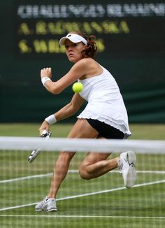 Agnieszka Radwanska of Poland hits a forehand return during her Ladies' Singles final match against Serena Williams of the USA on day twelve of the Wimbledon Lawn Tennis Championships at the All England Lawn Tennis and Croquet Club on July 7, 2012 in London, England