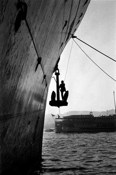 The man painting the anchor of a boat, Karakoy, 1954,  photo by Ara Güler (please repin with photographers credits)