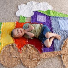 $65.00 Alex just loves his Train rag quilt. For an idea on size he is 3.