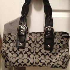 Authentic black coach bag, barely used! Measures 12 wide by 9 high. Nice size bag! Zip closure. No damage. Coach Bags