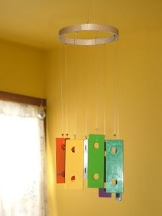 wind chime from a broken toy xylophone - love this!!!  How fun!!  Garage sales or good will!!