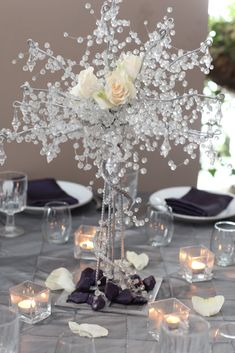 A sparkling wedding table centerpiece. I would use less splarkles and more flowers.