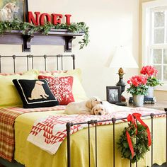 Guest Room with Holiday Cheer  To pamper visiting family and friends, consider adding a few extra touches to the guest bedroom. Add a bright pop of color with a throw pillow and an extra quilt. To brighten the side of the bed, include a few red blooms in tin containers, and carry through the same color with a ribbon accent for a bottom-of-the-bed fir wreath. Spray-paint paper letters with a welcoming holiday message and set them atop a fir garland on a nearby shelf or table.