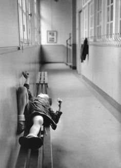 Robert Doisneau // Punished pupil waiting lying on a bench In 1956.