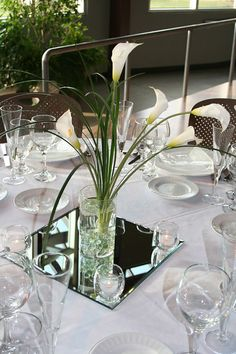 centerpieces on a mirror surrounding with votive candle | ... glass marbles, set on a beveled edge mirror with 4 votive candles