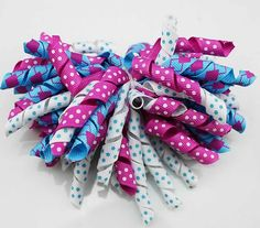 "A bunch of pretty 3/8"" elastic and soft korker grosgrain curling ribbon hair bow"