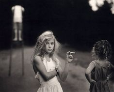 Photograph by Sally Mann. Although the cigarette is a candy cigarette, the way the girl holds it and everything about her makes it seem real. It makes me wonder what she's thinking.
