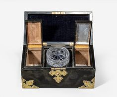 A Victorian period ebony and brass bound tea caddy in the form of a casket with original glass mixing bowl.