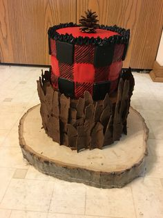 This was the cake I made for my son's first birthday party! It was a lumberjack birthday party and I wanted the bottom tier to look like ragged tree bark.
