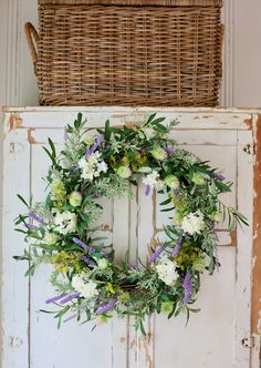 A collection of French Country Cottage brand faux floral arrangements, wreaths and garlands with Balsam Hill French Country Cottage, French Country Style, French Country Decorating, Cottage Decorating, Porches, Cork, Vintage Picnic Basket, Wreaths And Garlands, Rustic Wreaths