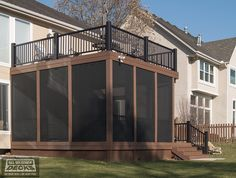Azek Composite Deck with Azek Handrails, Solar Screens and Aluminum Under Deck Guttering System / Under Deck Ceiling in Parkville, MO