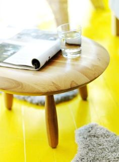canary yellow painted floor in a swedish home.  #brightcolors #sunshineyellow #paintedwoodfloor