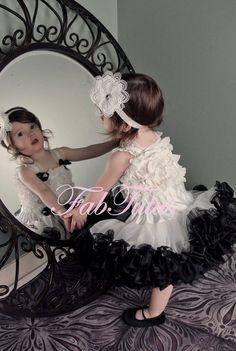 White Pettiskirt with Black Ruffle and a White Ruffle Top Set By FabTutus. $84.99, via Etsy.
