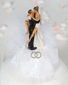 This beautiful cake topper features a pair of entwined rhinestone rings on an organza bow and tulle. The funny, sexy African American bride and groom will be sure to make a statement at your wedding shower or reception. Skirt is made of organza
