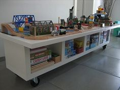 Ikea Hackers: Train/Lego/Play Table made from painted door frame screwed to Lack unit on casters so it can roll and to give it height. Our train table broke. This looks like a much better way to replace!
