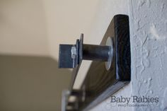 Baby Rabies   DIY Barn Door Track Tutorail--shows you what you need to do to bypass the door moldings
