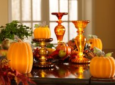 A striking way to dress up a mantle or sofa table for the fall season. Illuminated pumpkins at various heights using pedestals.