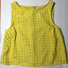 Elle yellow crop top BNWT!  PRODUCT FEATURES Zip-back crewneck Lined FABRIC & CARE Polyester Machine wash Imported Elle Tops Crop Tops