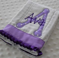 BuRP CLoTH with appliqued initial AND personalized embroidery with baby girl's name - PuRPLe. $11.99, via Etsy.
