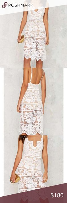 FOR LOVE & LEMONS DRESS Lace down, class up. The Gianna Dress comes in white sheer lace and features embroidered floral detailing throughout, thin adjustable shoulder straps, scalloped V-neckline and hem, hidden back zip and hook closure, bodycon midi silhouette, and beige bodysuit with snap closure.  *Cotton/Nylon/Spandex  *Runs true to size  *Dry clean only  *Imported For Love and Lemons Dresses Midi