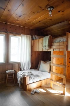 """Lauren designed the custom bunk beds to continue the lines of the existing paneling.""""The staggered configuration of bunks creates some space underneath,"""" she says. """"The setup works with the shape of t Small Cabin Interiors, Modern Cabin Interior, Cabin Interior Design, Small Cabin Decor, Modern Cabin Decor, Lake Cabin Decorating, Small Cabin Designs, Modern Loft, Decorating Ideas"""