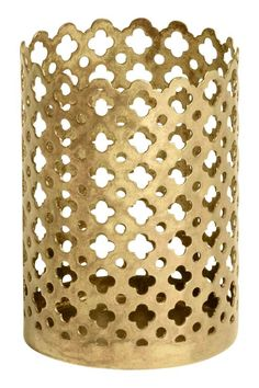 Small tealight holder: Small, cylindrical tealight holder in metal with a  punched pattern. Diameter 5 cm, height 7 cm.
