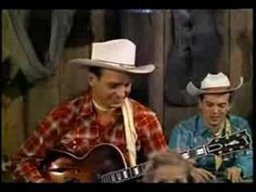 """Ernest Tubb performs """"Walkin the floor over you"""" with fiddle player Bobby Atcheson"""