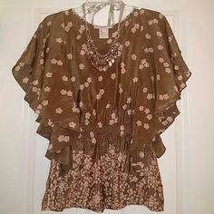 """NWOT Beautiful Cherry Blossom silk top It may be winter, but you'll """"think spring"""" in this cherry blossom silk top from Paul and Joe Sister.  Cocoa brown with soft pink flowers. Elegant flowy sleeves (full coverage on sides) and peplum waist.  Never worn!!  Necklace not included. Paul and Joe Sister Tops Blouses"""