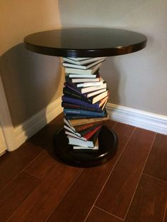 DYI Library table. Tuesday Morning table $49. Dollar Store hardback books. Easy. love it!