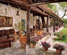 Outdoor Living Space - To continue the feel of a Spanish Colonial home in the outdoors you can see how the elements of dark wood, copper, wrought iron and leather can work well in a covered outdoor space.