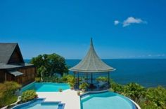 Oceanfront Ohana Villa for sale in Scarborough, Trinidad and Tobago. Stunning beach and ocean views from all rooms.