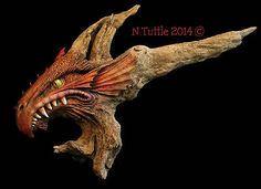 """Dragon's Blood""    This fierce dragon measures 20 inches in length and 14 inches tall.             Everything was carved into a single piece of driftwood.          Signed and dated:  N. Tuttle 4/13/14"