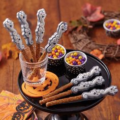Ghost Candy Melts® Candy Pretzels from @michaelsstores.  Wilton® Silver Color Mist™ Food Color Spray adds an eerie shadow to these molded Candy Melts® candy pretzels.