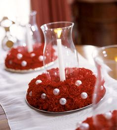 Make a fresh Christmas centerpiece with wreath bases, pearl beads, and scarlet carnations.