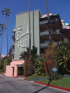 """The classic Beverly Hills Hotel and Bungalows. The hotel used for the cover of the Eagles album """" Hotel California"""""""