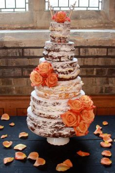 Naked weddng cake...I'd make it with browie, dusted with powdered sugar and then with yellow flowers