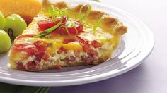 Enjoy dinner tonight with this cheesy ham and tomato quiche recipe that's baked using Pillsbury® refrigerated pie crusts - ready in an hour .
