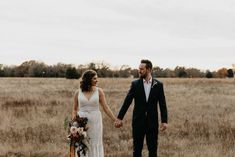 Wedding couple holding hands in a wide-open field | Image by Marissa Merrill Photography Wedding Blog, Wedding Styles, Wedding Photos, Bohemian Wedding Inspiration, Boho Wedding Decorations, Fall Wedding Colors, Floral Crown, Boho Wedding Dress, Wedding Couples