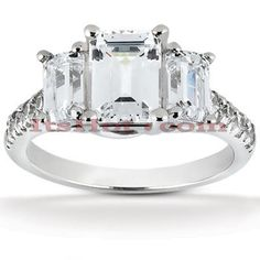 This 14K Gold Three Stone Diamond Engagement Ring  showcases a 1 carat emerald cut diamond in the center and 0.91 carat of round & emerald cut diamonds on the sides for a total of 1.91 carat of dazzling diamonds and is available in Platinum, 18k or 14k yellow, rose, white gold, various sizes, and can be customized with any color and quality diamonds. Center diamond can be from 1ct to 1.50ct (gold weight and number of stones may vary). Please note: it will take us 3-5 business days to make…