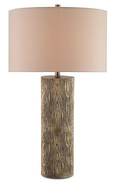 The Landseer Table Lamp has a natural wood grain look that is a handsome motif that enriches indoor spaces with the allure of the outdoors. An Antique Brass finish adds subtle sheen to the hand-cast aluminum body. Capped by a neutral Tan Sand Linen shade. Shop Lovecup.com for table lamps, floor lamps, chandeliers and wall sconces.