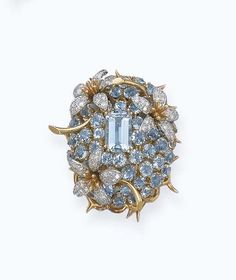 AN AQUAMARINE AND DIAMOND FLORAL BROOCH, BY JEAN SCHLUMBERGER: