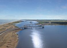 Architect Rafael Viñoly has completed a ring-shaped road bridge that stretches across a lagoon on Uruguay's southern coast