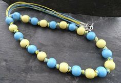 Blue and yellow wooden bead knotted necklace with heart shaped clasp Knot Necklace, Simple Necklace, Beaded Bracelets, Necklaces, Organza Gift Bags, Handmade Jewellery, Wooden Beads, Heart Shapes, Yellow